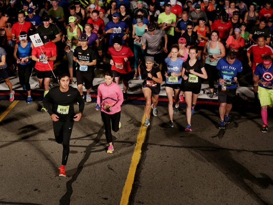 Runners cross the start line during the 39th annual