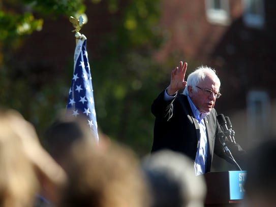 Sen. Bernie Sanders speaks to a crowd at College Green