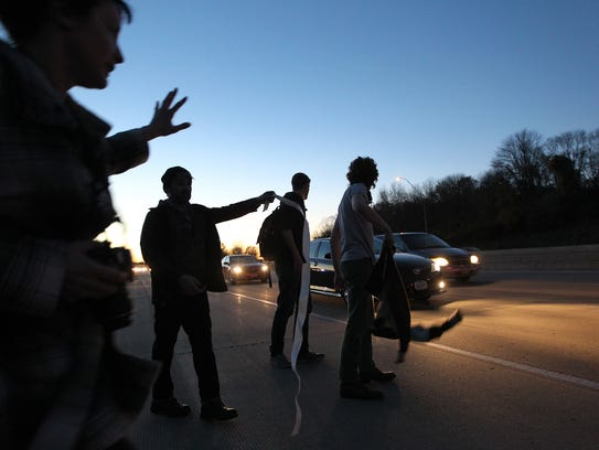 Protesters slow down traffic before blocking lanes