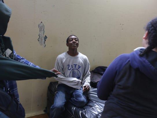 Eighth-grade student Keeto Gaines, 14, center talks