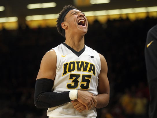 Iowa's Cordell Pemsl celebrates a basket during the