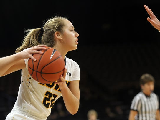 Iowa's Kathleen Doyle looks for an open teammate during