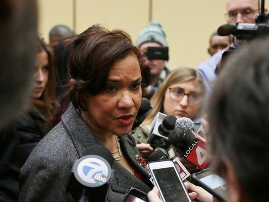 Flint Mayor Karen Weaver talks with press after Attorney