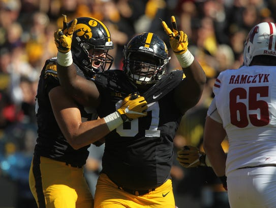 Iowa's Jaleel Johnson celebrates his second sack during