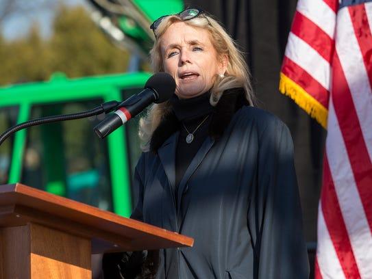 Congresswoman Debbie Dingell speaks alongside senators