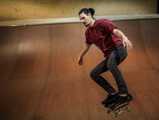 Nick Mullins, 25, skateboards at Modern Skate & Surf