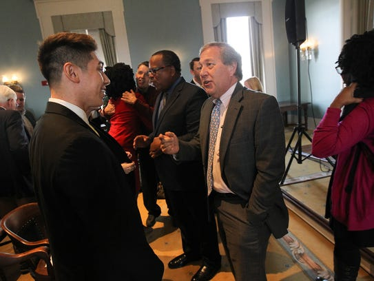 University of Iowa President Bruce Harreld chats with