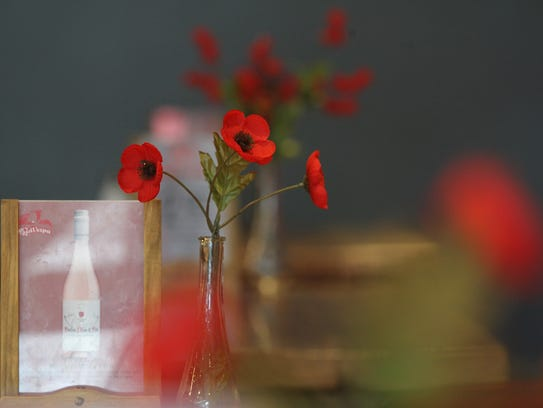 Flowers decorate tables at Red Vespa in Solon on Friday,