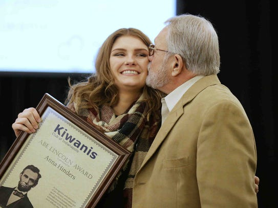 Anna Hinders receives a kiss from her grandfather,