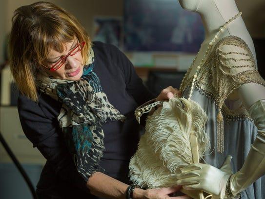 Broadway dresser Nancy Lawson works on fitting costumes