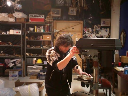 Eric Geiner, 44 drills through a stone in his studio