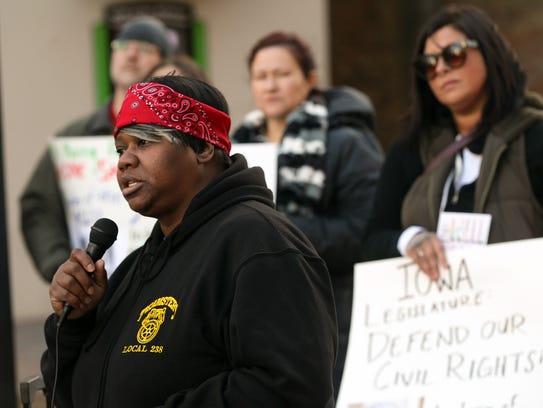 Royceann Porter speaks to protesters on the pedestrian