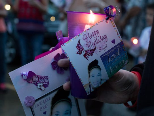 A photo of Breanna Wood along with a candle is held