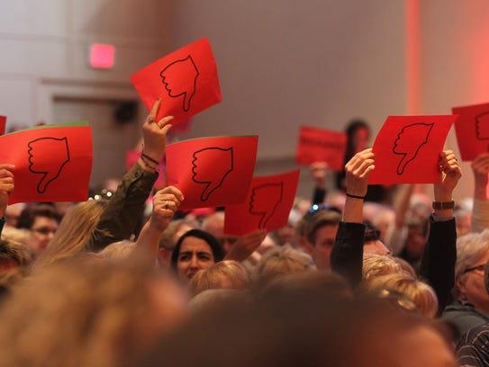 Community members give Sen. Joni Ernst (R-Iowa) a thumbs