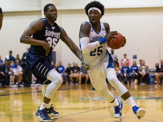 Texas A&M-Corpus Christi's Rashawn Thomas drives the