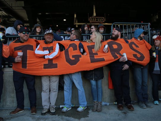Tigers fans wear an extended shirt they sewed in 2006, during Opening Day last year against the Red Sox.
