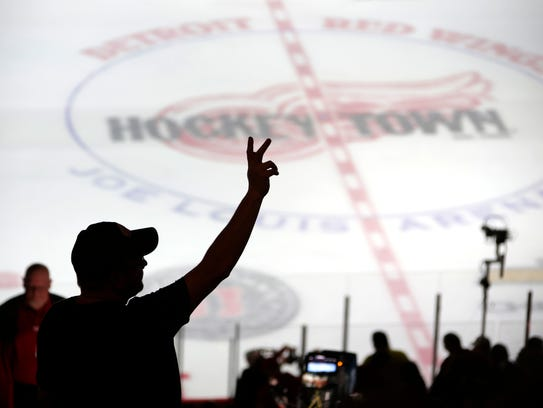 Red Wings fans react during pregame ceremonies against