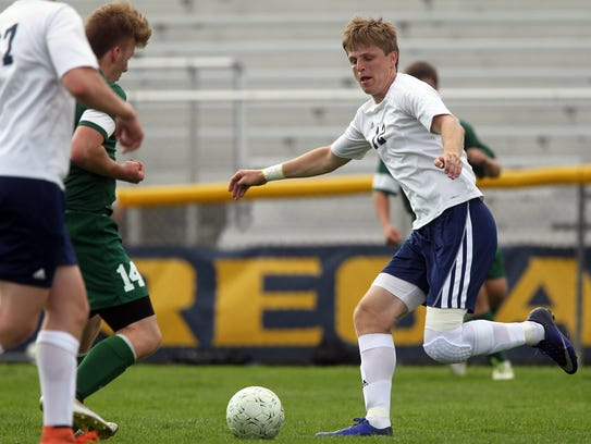 Regina's Tommy Rapp takes the ball down field during