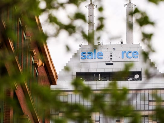 Salesforce lettering is seen mid-completion, replacing