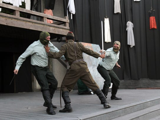 """Actors rehearse a scene from """"Macbeth"""" at the Riverside"""