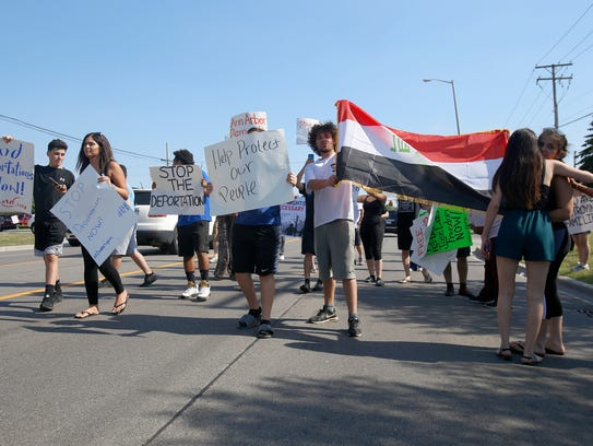 Family, friends and community members take to the street