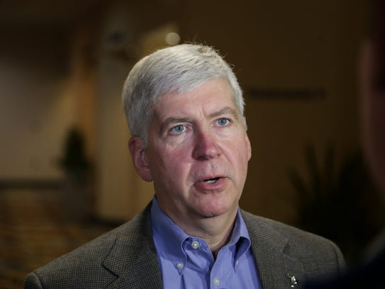 Governor Rick Snyder talks with press outside of the