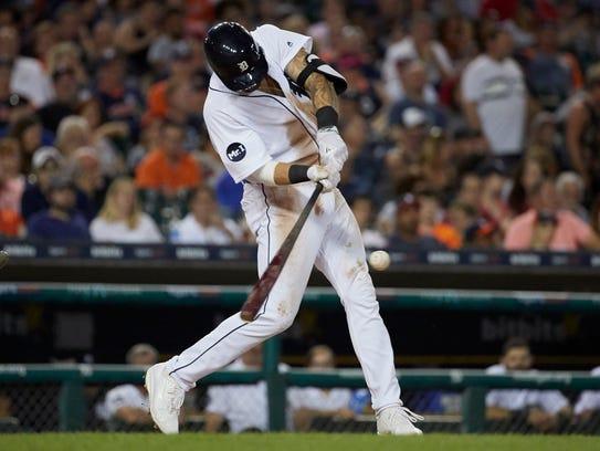 Tigers third baseman Nick Castellanos (9) hits a two-RBI