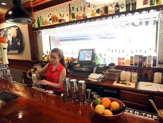 Tiffany Carter pours drinks at Atlas on Friday, June