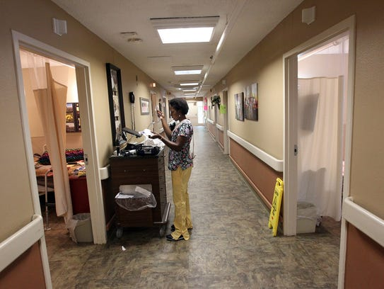 Yvonne Nampore helps with residents before lunch at