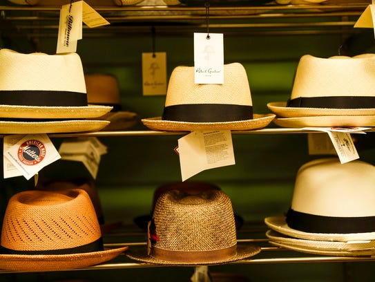 Hats are seen on the shelf in Henry the Hatter on Friday,