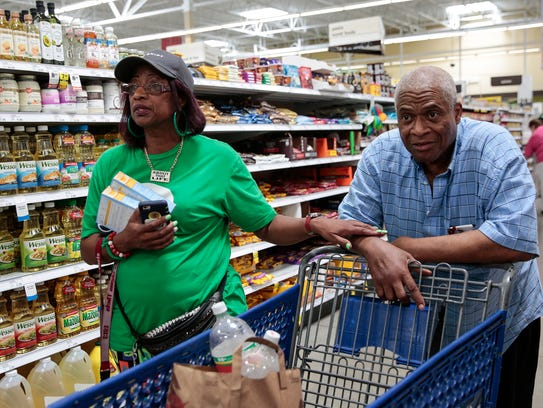 Shipt shopper Gina Moorman of Detroit helps William