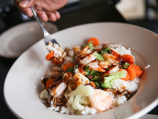 A grilled shrimp rice bowl served at the Stacked Pickle