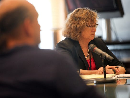 Johnson County Attorney Janet Lyness listens to Judge