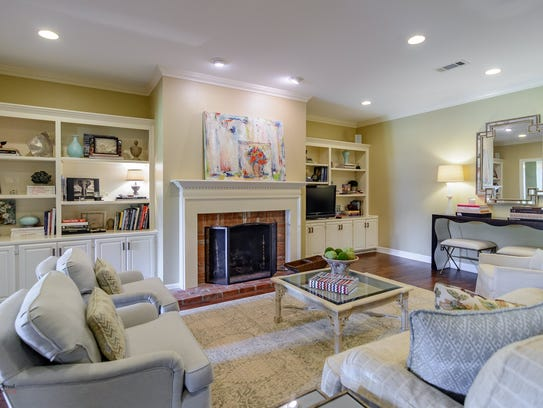 The home includes multiple rooms with built-ins.