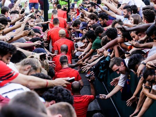 Paris Saint-Germain F.C. fans gather over the tunnel