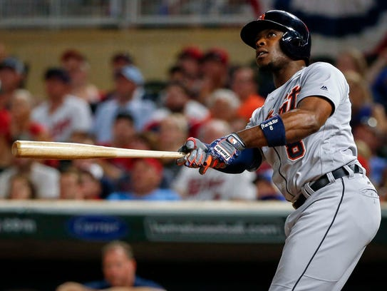 Tigers leftfielder Justin Upton hits a three-run home
