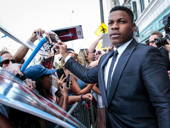 "John Boyega signs autographs for fans during the ""Detroit"""