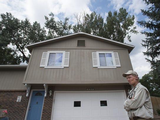 Fort Collins resident Jim Henriksen stands in front