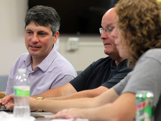 Bennett Brown, left, works with fellow teachers during