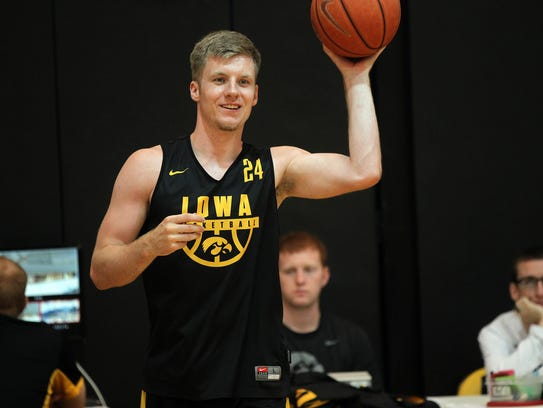 Iowa's Brady Ellingson warms up during practice at