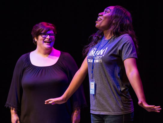 Nancy Hayden, left, and Amana Moore perform during