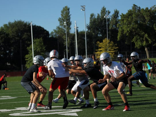 City High teammates run drills during practice on Tuesday,