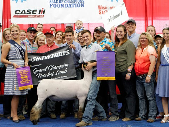 Brady Meudt, of Walworth County, and his Grand Champion