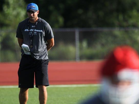 Clear Creek Amana head coach Gabe Bakker watches players