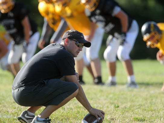 Mid-Prairie head coach Pete Cavanagh works with players