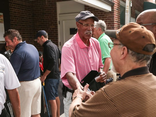 Former Detroit Mayor Dave Bing talks with other golfers