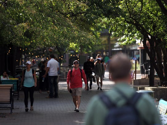 People fill the pedestrian mall on Tuesday, Aug. 29,
