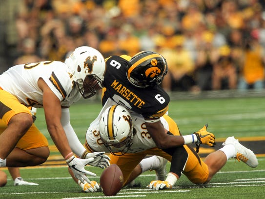 Iowa wide receiver Ihmir Smith-Marsette fumbles the