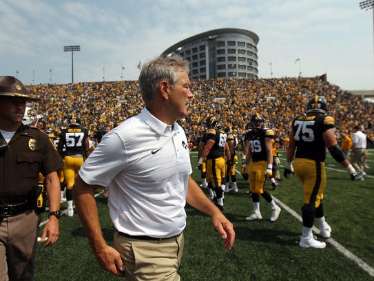 Iowa head coach Kirk Ferentz heads to the locker room