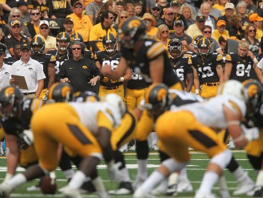 Iowa quarterbacks coach Ken O'Keefe watches Nate Stanley